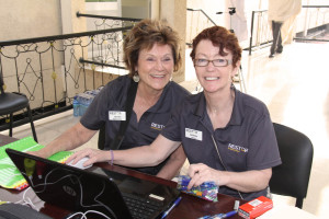 Mission Director Jean Bird (left) with Deb Nolan at the admissions desk.